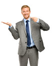 Happy young businessman showing empty copyspace on white backgro copy space Stock Images