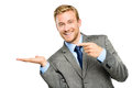 Happy young businessman showing empty copyspace on white background