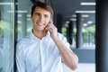 Happy young businessman talking on cell phone Royalty Free Stock Photo