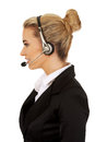 Happy young businesswoman with headset Royalty Free Stock Photos