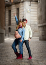 Happy young cool latin couple together outdoors with pregnant woman showing belly women and trendy men wearing casual Stock Images