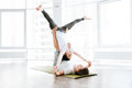 stock image of  Happy young couple balancing and doing acro yog