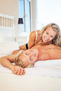 Happy young couple in bed Royalty Free Stock Image