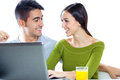 Happy young couple browsing internet at home portrait of Stock Photos