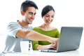 Happy young couple browsing internet at home portrait of Stock Photo