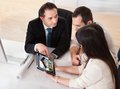 Happy young couple discussing with consultant in office Royalty Free Stock Photography