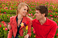 Happy young couple in Dutch flower fields Royalty Free Stock Photography