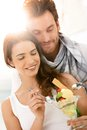 Happy young couple eating icecream on summer beach smiling Royalty Free Stock Image