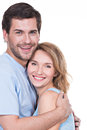 Happy young couple in embrace portrait of standing on white background Stock Images