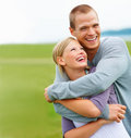 Happy young couple embracing eachother outdoors Royalty Free Stock Image