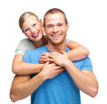 Happy young couple embracing over white Royalty Free Stock Photo