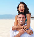 Happy young couple enjoying on beach Royalty Free Stock Photography