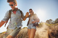 Happy young couple enjoying their hiking trip outdoor shot of on walking down the mountain trail smiling caucasian having Stock Images
