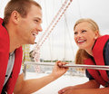 Happy young couple enjoying their sea voyage Royalty Free Stock Image