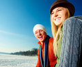 Happy young couple enjoying their winter vacation Royalty Free Stock Photography