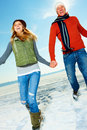 Happy young couple enjoying their winter vacation Stock Image