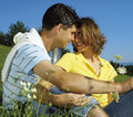 Happy young couple in field Royalty Free Stock Images