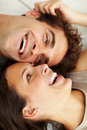 Happy young couple on floor smiling together Stock Image