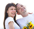 Happy young couple with flowers Royalty Free Stock Photography