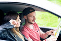 Happy young couple, friends making selfie while sitting in car. Summer time. Caucasian people. Concept of transportation. Royalty Free Stock Photo