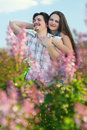Happy Young Couple in garden of flowers Stock Photography