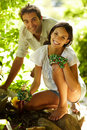 Happy young couple gardening outdoors smiling Royalty Free Stock Image
