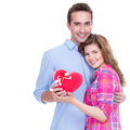 Happy young couple with a gift in studio isolated on white background Royalty Free Stock Photo