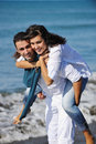 Happy young couple have fun at beautiful beach Royalty Free Stock Images