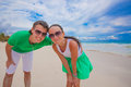 Happy young couple have fun on exotic beach looking at camera this image has attached release Stock Photo