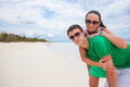 Happy young couple have fun on exotic beach looking at camera this image has attached release Royalty Free Stock Photography