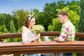 Happy young couple having a date on a bridge in the park Royalty Free Stock Photo