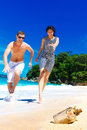 Happy young couple having fun on the shore of a tropical island summer vacation concept Royalty Free Stock Photography