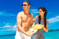 Happy young couple having fun on the shore of a tropical island summer vacation concept Royalty Free Stock Photos
