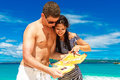 Happy young couple having fun on the shore of a tropical island summer vacation concept Stock Images