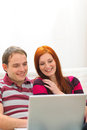 Happy young couple having fun time with laptop Royalty Free Stock Photography