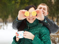 Happy young couple having fun in the winter park Stock Photos