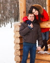 Happy young couple having fun in the winter park love Royalty Free Stock Photography