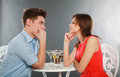 Happy young couple having romantic dinner indoors studio grey Stock Photos
