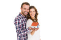 Happy young couple holding model house Royalty Free Stock Photo
