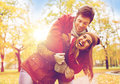 Happy young couple hugging in autumn park Royalty Free Stock Photo