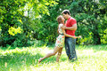 Happy young couple kissing outdoor in the park Royalty Free Stock Images