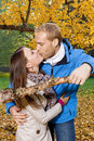 Happy young couple kissing portrait of a in the park Royalty Free Stock Image