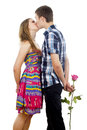 Happy young couple kissing with rose Royalty Free Stock Images