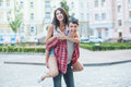 Happy young couple laughing in the city. Love Story series. Royalty Free Stock Photo