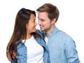 Happy young couple looking at each other interracial isolated on white Royalty Free Stock Photography
