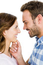Happy young couple looking at each other and smiling on white background Royalty Free Stock Photography