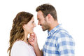 Happy young couple looking at each other and smiling on white background Stock Photo