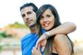 Happy young couple looking at something interesting - Copyspace Royalty Free Stock Photo