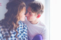 Happy young couple in love close to each other tenderly kissing Royalty Free Stock Photo