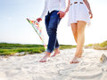 Happy young couple in love with flying a kite on the beach Stock Images